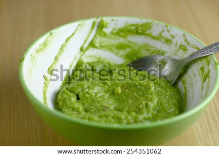 avocado cream in green bowl - stock photo