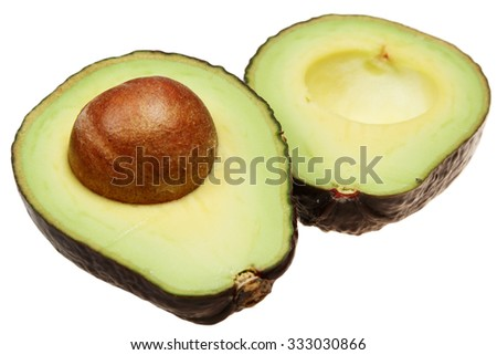 Avocado cut in half on a white background