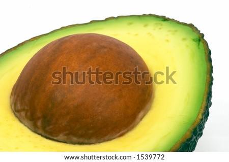 Avocado cut macro / closeup, isolated white background - stock photo