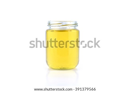 Avocado fruit oil extract in glass vial over white background - stock photo
