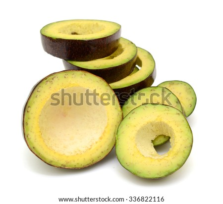 Avocado fruit with slices isolated on white background