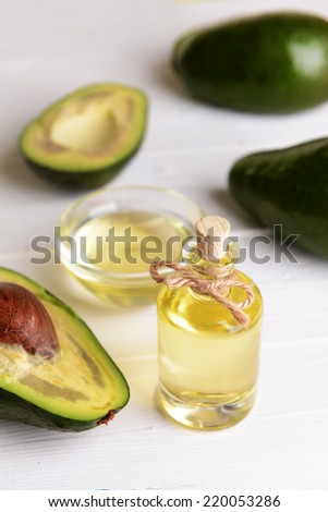 Avocado oil on table close-up - stock photo