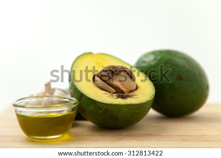 Avocado ,olive oil,and garlic are good ingredient for a green food - stock photo