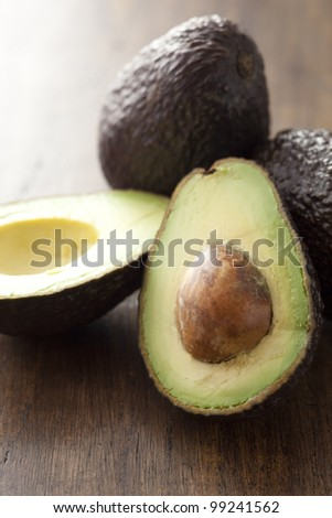 avocado on the old wood board - stock photo