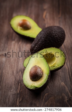 Avocado on wooden table  - stock photo