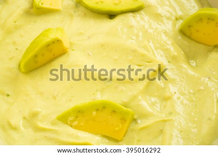 avocado paste garnished with avocado slices  - stock photo