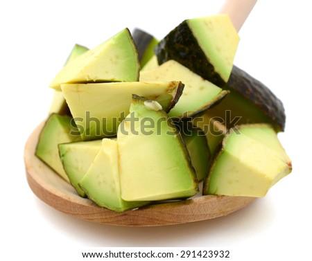 avocado slices on wooden spoon isolated on white  - stock photo