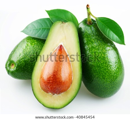 Avocado with leaves on a white background.