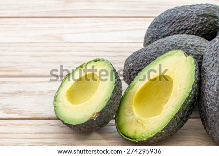 Avocados on a wood table - stock photo