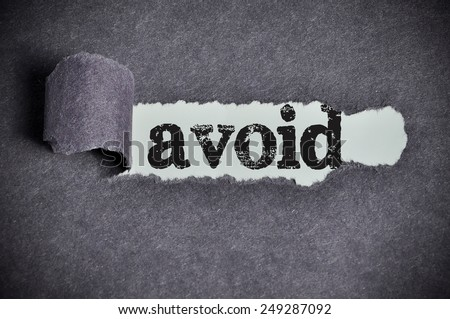 avoid word under torn black sugar paper  - stock photo