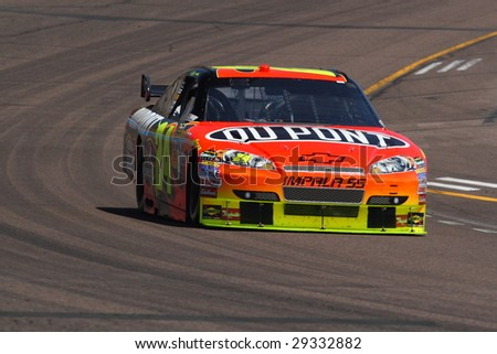 AVONDALE, AZ - APRIL 17: Jeff Gordon (24) drives his Chevrolet for qualification in the NASCAR Sprint Cup Series race at Phoenix International Raceway April 18, 2009 in Avondale, AZ. - stock photo