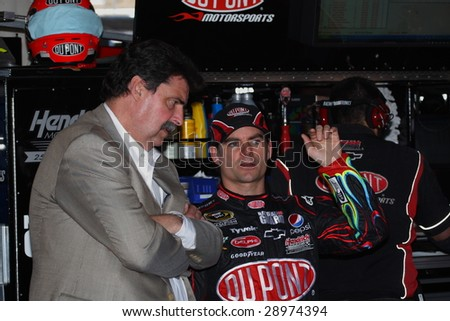 AVONDALE, AZ - APRIL 17: Jeff Gordon talks about his car setup in the garage between practice sessions for the NASCAR Sprint Cup Series race at PIR, on Friday, April 17, 2009 in Avondale, AZ. - stock photo