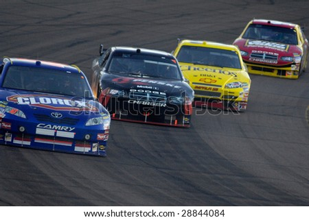 AVONDALE, AZ - APRIL 18: Marcus Ambrose #47 leads a group of cars at the NASCAR Sprint Cup race at the Phoenix International Raceway on April 18, 2009 in Avondale, AZ.