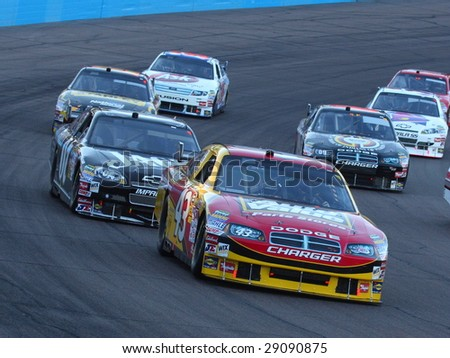 AVONDALE, AZ - APRIL 18: Reed Sorenson (43) tries to stay ahead of a group of cars in the NASCAR Sprint Cup Series race at Phoenix International Raceway April 18, 2009 in Avondale, AZ. - stock photo