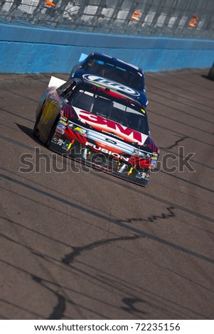 AVONDALE, AZ - FEB 27:  Greg Biffle (16) drives his 3M Ford during the Subway Fresh Fit 500 race at the Phoenix International Raceway in Avondale, AZ on Feb 27, 2011. - stock photo