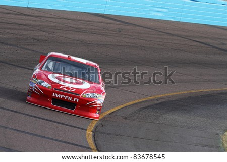 AVONDALE, AZ - FEB 25: Juan Pablo Montoya (42) at speed in a practice session for the SUBWAY Fresh Fit 500 race on Feb. 25, 2011 at the Phoenix International Raceway in Avondale, AZ. - stock photo