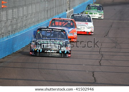 AVONDALE, AZ - NOV. 12: Colin Braun (6) leads several trucks down the front straight in a practice session for the Lucas Oil 150 at Phoenix International Raceway on November 12, 2009 in Avondale, AZ.