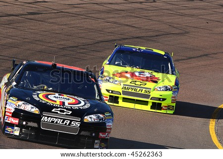 AVONDALE, AZ - NOV. 14: David Gilliland leads Mark Martin during a practice session for the NASCAR Sprint Cup race, at Phoenix International Raceway on Nov. 14, 2009 in Avondale, AZ. - stock photo