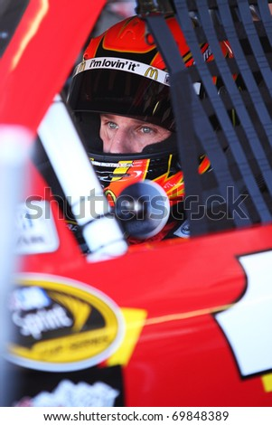 AVONDALE, AZ - NOV 13: Jamie McMurray (1) waits in his car before a practice session for the Kobalt Tools 500 race on Nov 13, 2010 at the Phoenix International Raceway in Avondale, AZ. - stock photo