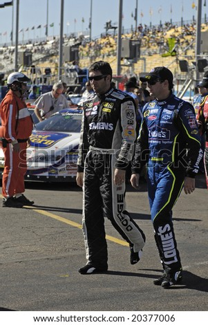 AVONDALE, AZ - NOV 7 - Jimmie Johnson (48) and Elliott Sadler (19) walk off the track at the NASCAR Sprint Cup race at the Phoenix International Raceway on November 7, 2008 in Avondale, Arizona.