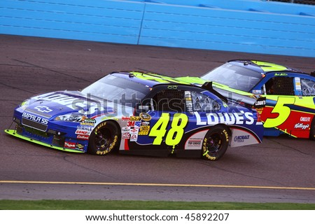 AVONDALE, AZ - NOV. 15:Jimmie Johnson (48) and Mark Martin (5) in the NASCAR Sprint Cup Series, Checker O'Reilly Auto Parts 500 at Phoenix International Raceway on Nov. 15, 2009 in Avondale, AZ. - stock photo
