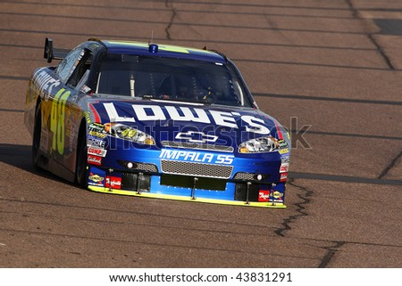 AVONDALE, AZ - NOV. 13: Jimmie Johnson (48) takes laps during a practice session for the NASCAR Sprint Cup Series race at Phoenix International Raceway on Nov. 13, 2009 in Avondale, AZ