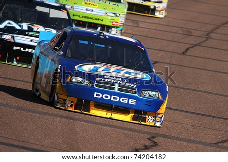 AVONDALE, AZ - NOV 14: Kurt Busch (2) and Carl Edwards (99) in the Kobalt Tools 500 race on Nov 14, 2010 at the Phoenix International Raceway in Avondale, AZ.