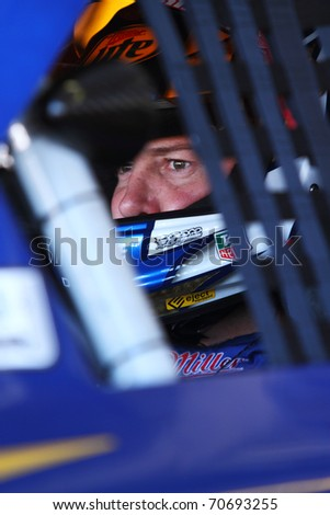 AVONDALE, AZ - NOV 13: Kurt Busch (2) waits in his car before a practice session for the Kobalt Tools 500 race on Nov 13, 2010 at the Phoenix International Raceway in Avondale, AZ. - stock photo