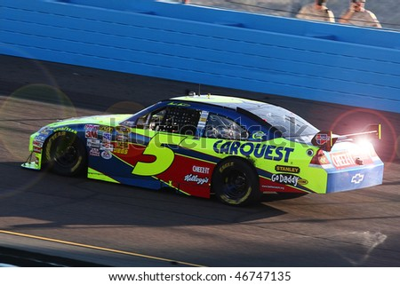 AVONDALE, AZ - NOV. 15:Mark Martin's (5) car glistens in the sun during the NASCAR Sprint Cup Series, Checker O'Reilly Auto Parts 500 at Phoenix International Raceway on Nov. 15, 2009 in Avondale, AZ. - stock photo