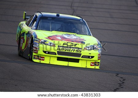 AVONDALE, AZ - NOV. 13: Mark Martin (5) takes laps during a practice session for the NASCAR Sprint Cup Series race at Phoenix International Raceway on Nov. 13, 2009 in Avondale, AZ - stock photo