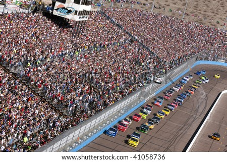 AVONDALE, AZ - NOV 15: The NASCAR Cup Series teams take to the track for the Checker O'Reilly Auto Parts 500 race at the Phoenix International Raceway on November 15, 2009 in Avondale, AZ. - stock photo