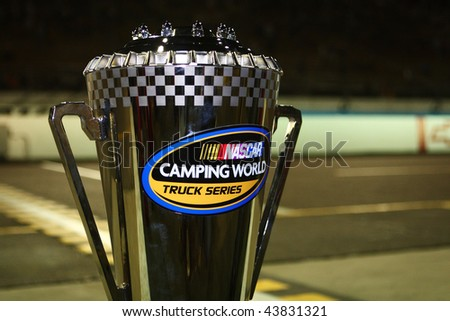 AVONDALE, AZ - NOV. 13: The points winning trophy for the NASCAR Camping World Truck Series sits on pit wall at Phoenix International Raceway on Nov. 13, 2009 in Avondale, AZ. - stock photo