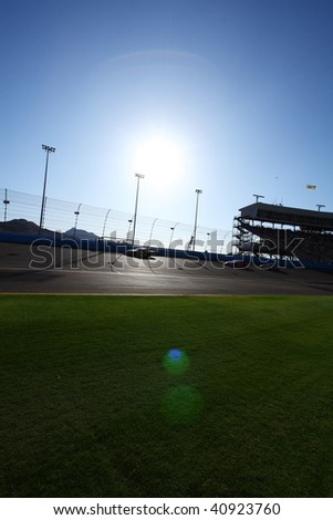 AVONDALE, AZ - NOVEMBER 14: Drivers battle bright sun during the NASCAR Nationwide Series, Able Body Labor 200 at Phoenix International Raceway on November 14, 2009 in Avondale, AZ. - stock photo