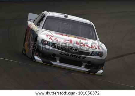 AVONDALE, AZ - OCT 4: Brian Vickers (83) takes laps during a NASCAR Sprint Cup track testing session on Oct. 4, 2011 at Phoenix International Raceway in Avondale, AZ. - stock photo