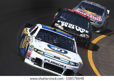 AVONDALE, AZ - OCT 5: Greg Biffle (16) leads a line of cars during a NASCAR Sprint Cup track testing session on Oct. 5, 2011 at Phoenix International Raceway in Avondale, AZ.