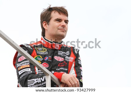 AVONDALE, AZ - OCT 4: Jeff Gordon watches from the top of the team hauler during a track testing session on Oct. 4, 2011 at Phoenix International Raceway in Avondale, AZ. - stock photo