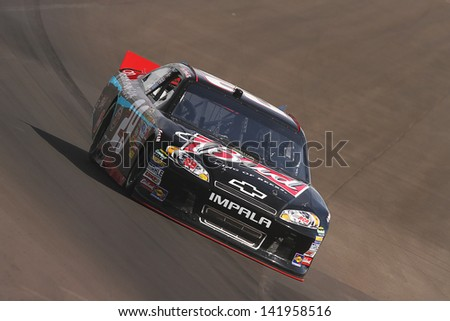 AVONDALE, AZ - OCT 5: Kevin Harvick (29) takes hot laps during a NASCAR Sprint Cup track testing session on Oct. 5, 2011 at Phoenix International Raceway in Avondale, AZ. - stock photo