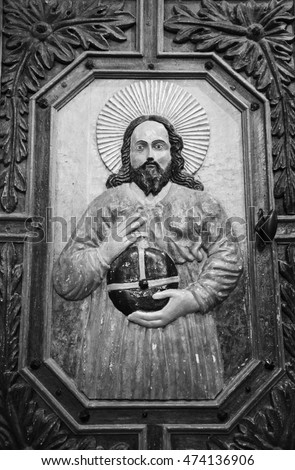 AVRIEUX, FRANCE - AUGUST 11, 2016: Door carving depicting Christ with right hand raised in blessing and left hand holding orb surmounted by cross (globus cruciger) in baroque church of Thomas Becket.