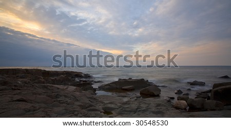 Awaiting the morning storm on the leading edge of the clouds at Brighton Beach along the North Shore of Lake Superior in Duluth Minnesota - stock photo