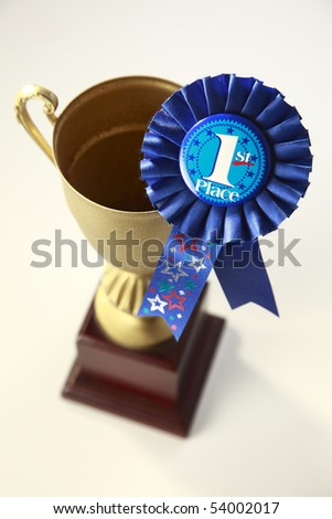 award badge and trophy on the plain background - stock photo