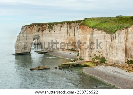 Awesome cliffs of Etretat in Normandy - stock photo