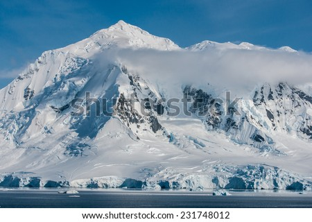 Awesome ice covered mountains in Antarctica  - stock photo