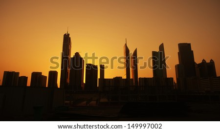 awesome sunset over modern city - stock photo