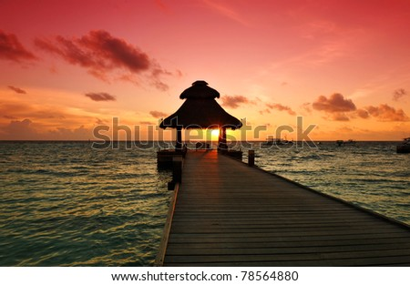 Awesome vivid sunset over the jetty in the Indian ocean, Maldives. HDR - stock photo