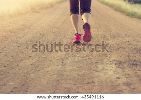 aWoman running exercise on trail in summer nature, Blank text - stock photo