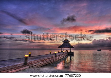 Awsome vivid sunset over the jetty in the Indian ocean, Maldives. HDR - stock photo