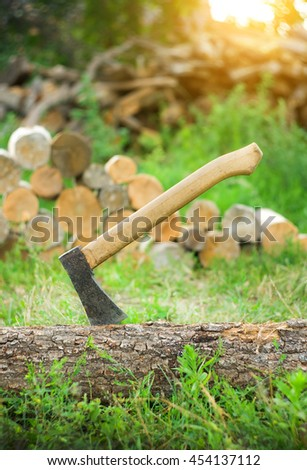 Axe in a log, closeup.Ready for cutting timber - stock photo