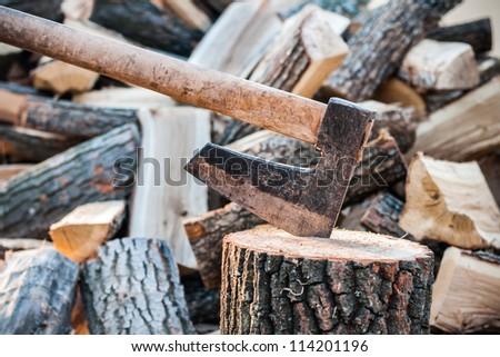 Axe with chopped logs close up