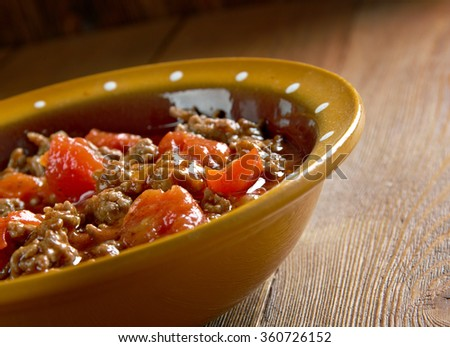 Axoa - traditional dish of the Basque country.minced beef with vegetables - stock photo