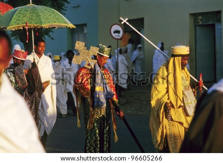 AXUM, ETHIOPIA - MAY 07: priest carries the holy ark in a ceremony through the streets on May 07,1998 in Axum, Ethiopia. The ark was stolen in Salomons temple by king Menelik. - stock photo